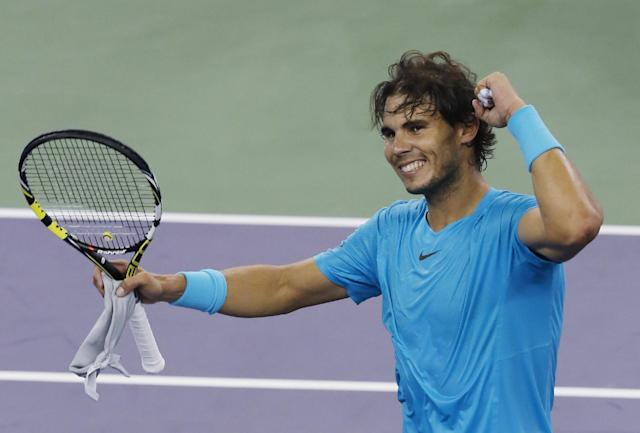 Rafael Nadal of Spain celebrates after defeating Switzerland's Stanislas Wawrinka during the singles quarterfinal match of the Shanghai Masters tennis tournament at Qizhong Forest Sports City Tennis Center, in Shanghai, China, Friday, Oct. 11, 2013. Nadal won 7-6, 6-1. (AP Photo/Eugene Hoshiko)