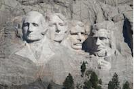 "<p>Mount Rushmore was crafted from raw materials, with workers carving 60-foot-tall heads of former U.S. presidents into the granite cliffs of South Dakota's Black Hills. A team of about 400 took roughly <a href=""https://www.popularmechanics.com/technology/a23605/75-years-mount-rushmore/"" rel=""nofollow noopener"" target=""_blank"" data-ylk=""slk:14 years to complete"" class=""link rapid-noclick-resp"">14 years to complete</a> the task, with no loss of life. During the process, workers primarily used dynamite to clear away 450,000 tons of rock, before carving the faces using facing bits and jackhammers.</p>"