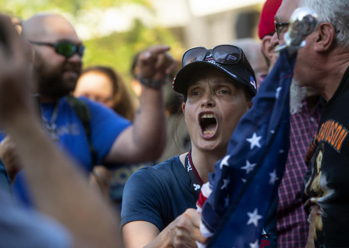 A supporter, foreground, of Republican Reps. Marjorie Taylor Greene and Matt Gaetz shouts as other supporters and counterprotesters spar verbally, during a protest held by Greene and Gaetz outside City Hall on Saturday, July, 17, 2021, in Riverside, Calif. (Cindy Yamanaka/The Orange County Register via AP)