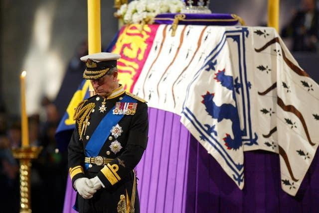 The Prince of Wales stands vigil beside the Queen Mother's coffin while it lies in state at Westminster Hall