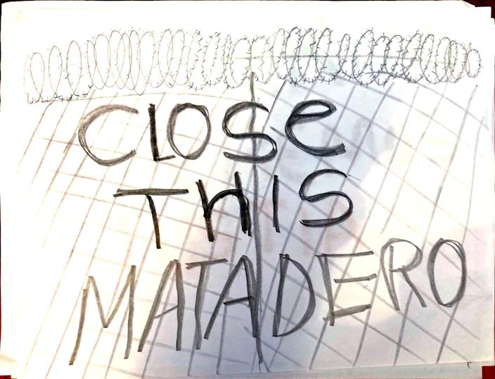 "A drawing supporting the Georgia detainees states ""Close this matadero,"" or ""Close this slaughterhouse."""