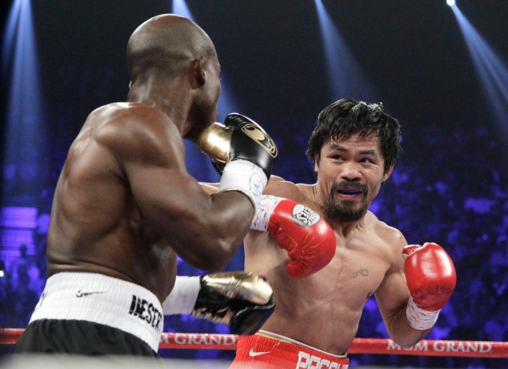 Manny Pacquiao, right, from the Philippines, and Timothy Bradley, from Palm Springs, Calif., work in the first round of their WBO welterweight title fight Saturday, June 9, 2012, in Las Vegas.