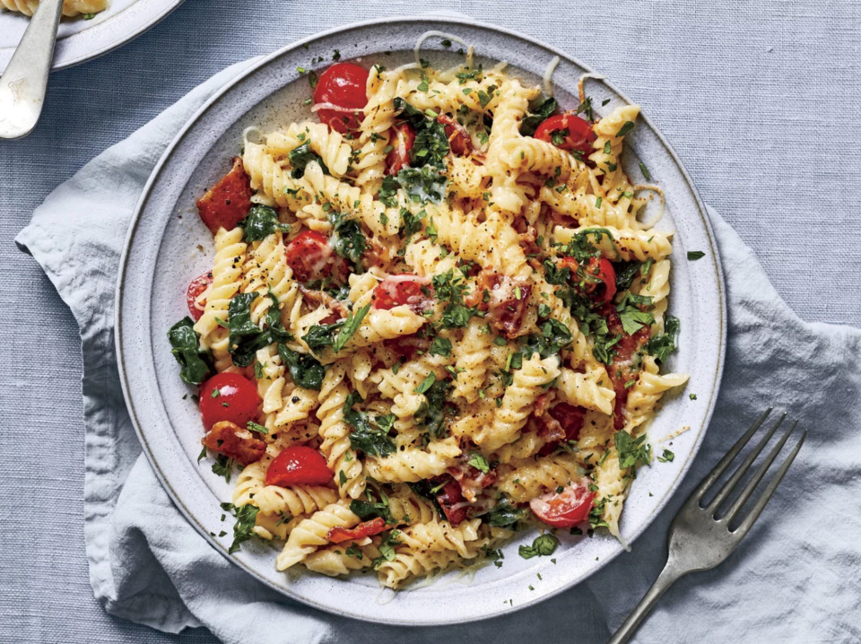 """<p><strong>Recipe: </strong><a href=""""https://www.southernliving.com/recipes/fusilli-pasta-spinach-tomato-bacon"""" rel=""""nofollow noopener"""" target=""""_blank"""" data-ylk=""""slk:Fusilli Pasta with Spinach, Tomato, and Bacon"""" class=""""link rapid-noclick-resp""""><strong>Fusilli Pasta with Spinach, Tomato, and Bacon</strong></a></p> <p>Your sheet pan is actually the secret to bubbly, cheesy pasta with golden edges.</p>"""