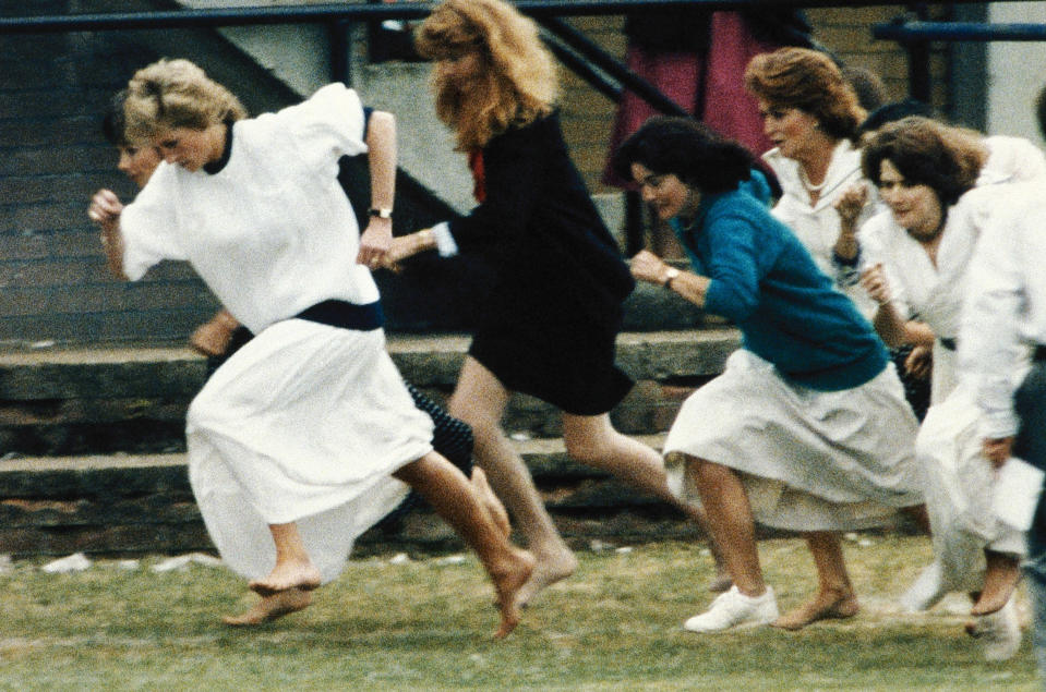 """FILE - In this file photo dated Tuesday, June 28, 1989, Britain's Princess Diana wearing a white dress, races ahead during the mother's race, held during a sports day for Wetherby school, where her son Prince William is a pupil. T For someone who began her life in the spotlight as """"Shy Di,"""" Princess Diana became an unlikely, revolutionary during her years in the House of Windsor. She helped modernize the monarchy by making it more personal, changing the way the royal family related to people. By interacting more intimately with the public -- kneeling to the level of children, sitting on edge of a patient's hospital bed, writing personal notes to her fans -- she set an example that has been followed by other royals as the monarchy worked to become more human and remain relevant in the 21st century. AP Photo, FILE)"""