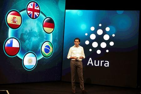 "Telefonica's chairman Alvarez-Pallete gestures as he presents ""AURA"" during an event in Barcelona"