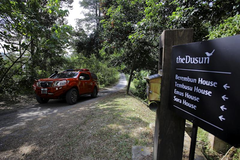 A vehicle from the Fire and Rescue Department's K9 Unit leaves The Dusun in Kampung Baru Pantai, Seremban August 5, 2019. — Bernama pic