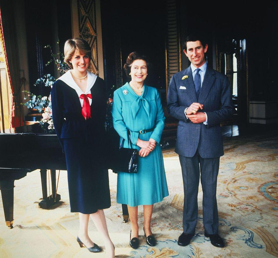 <p>Lady Diana, and Prince Charles and Queen Elizabeth pictured at Buckingham Palace on the day their wedding is sanctioned by the Privy Council.</p>