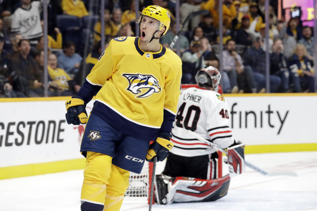 Nashville Predators center Nick Bonino (13) celebrates after scoring a goal against Chicago Blackhawks goaltender Robin Lehner (40), of Sweden, in the second period of an NHL hockey game Tuesday, Oct. 29, 2019, in Nashville, Tenn. (AP Photo/Mark Humphrey)