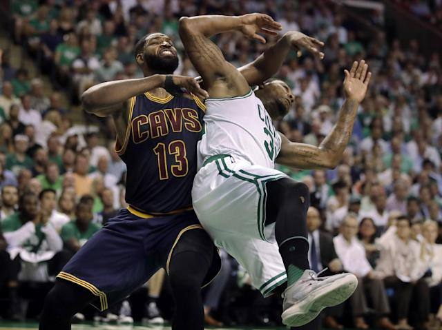 Cleveland Cavaliers center Tristan Thompson (13) and Boston Celtics guard Marcus Smart tangle during the third quarter of Game 1 of the NBA basketball Eastern Conference finals, Wednesday, May 17, 2017, in Boston. (AP Photo/Charles Krupa)