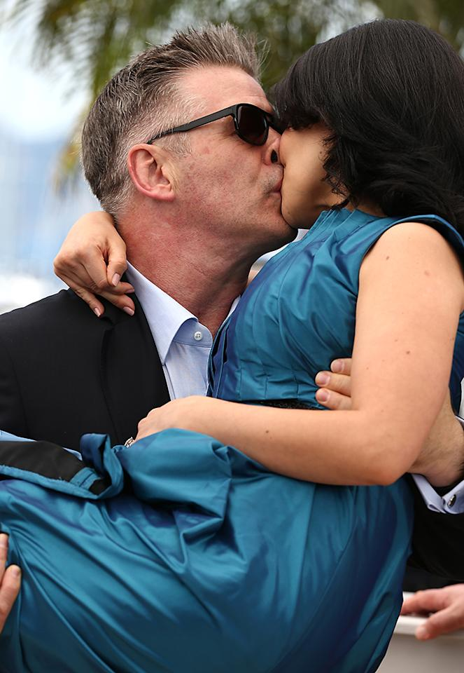 CANNES, FRANCE - MAY 21:  Actor Alec Baldwin kisses Hilaria Baldwin as they attend the 'Seduced And Abandoned' Photocall during The 66th Annual Cannes Film Festival at the Palais des Festivals on May 21, 2013 in Cannes, France.  (Photo by Andreas Rentz/Getty Images)