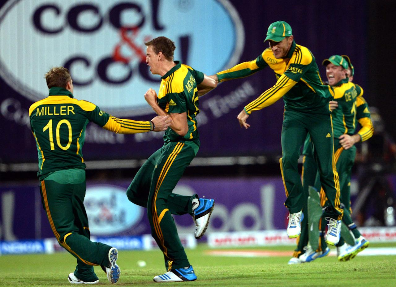 South African cricketers celebrate after winning the first one-day match against Pakistan in Sharjah Cricket Stadium in Sharjah on October 30, 2013. South African captain AB de Villiers won the toss and decided to bat in the first of five one-day internationals against Pakistan in Sharjah. AFP PHOTO/ Asif HASSAN        (Photo credit should read ASIF HASSAN/AFP/Getty Images)