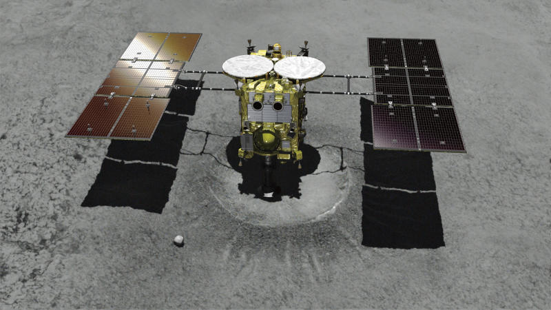 This computer graphics image provided by the Japan Aerospace Exploration Agency (JAXA) shows asteroid explorer Hayabusa2 landing on a crater that it made. The Japanese space explorer that will try to blow a crater in an asteroid and bring back samples from inside is nearing its destination after a 3 1/2 -year journey. The unmanned Hayabusa2 has arrived at the asteroid Wednesday, June 27, 2018, about 280 million kilometers (170 million miles) from Earth. (JAXA via AP)