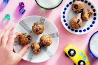 """Mix old-fashioned rolled oats and unsweetened coconut flakes with honey and nut butter to form these easy, portable, and delicious snacks. <a href=""""https://www.epicurious.com/recipes/food/views/no-bake-energy-bites-with-oats-and-dried-cherries?mbid=synd_yahoo_rss"""" rel=""""nofollow noopener"""" target=""""_blank"""" data-ylk=""""slk:See recipe."""" class=""""link rapid-noclick-resp"""">See recipe.</a>"""