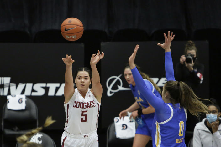 Washington State guard Charlisse Leger-Walker (5) shoots next to UCLA guard Chantel Horvat (0) during the first half of an NCAA college basketball game in Pullman, Wash., Friday, Feb. 5, 2021. (AP Photo/Young Kwak)