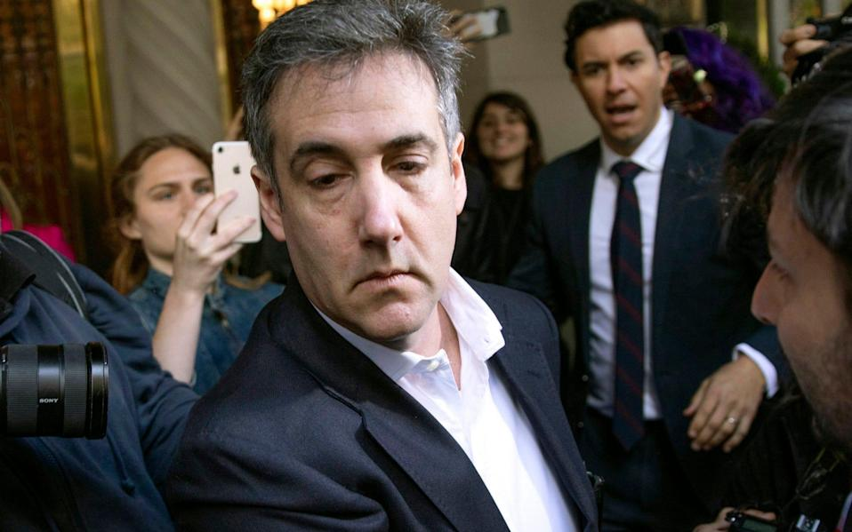 Michael Cohen, former attorney to President Donald Trump, leaves his apartment building before beginning his prison term in New York - Kevin Hagen/AP