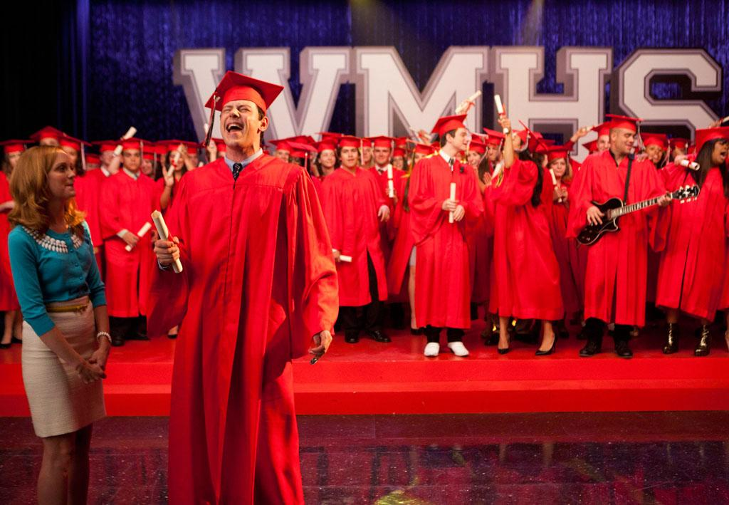"Finn (Cory Monteith) accepts his graduation diploma from Emma (Jayma Mays) in the ""Goodbye"" season finale episode of ""Glee."""