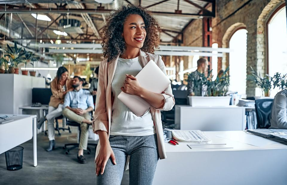 Group of young multiracial business people are working in modern office. Freelancers in coworking place. Creative and stylish youth.