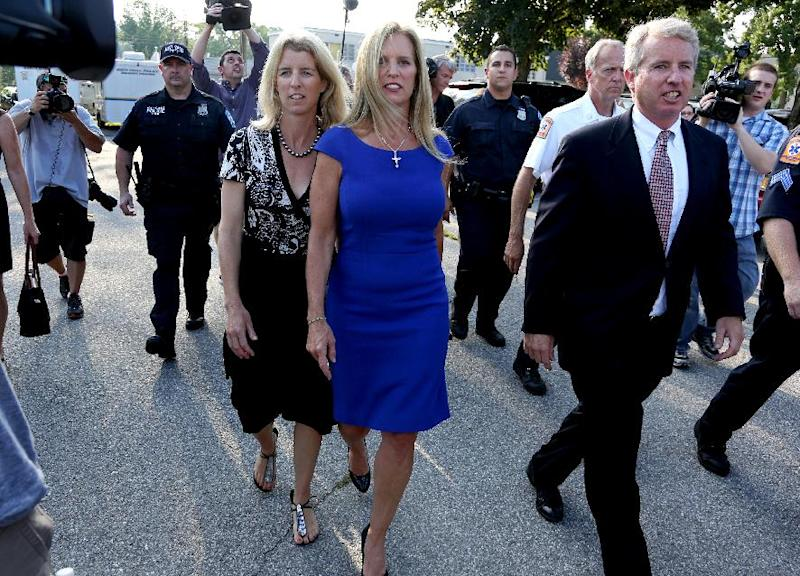 Kerry Kennedy, ex-wife of New York Gov. Andrew Cuomo, walks with family, members of the media and others after making a statement following a court appearance at the North Castle Justice Court in Armonk, N.Y. Tuesday, July 17, 2012. Kennedy was arrested Friday after state police said her Lexus struck a tractor-trailer on Interstate 684 north of New York City. Police said she drove the damaged car off the highway before it became disabled. (AP Photo/Craig Ruttle)