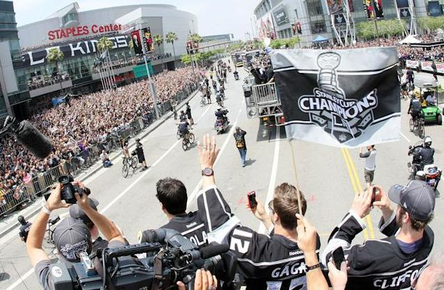 LOS ANGELES, CA - JUNE 14: Simon Gagne #12 of the Los Angeles Kings waves to fans during the Los Angeles Kings Stanley Cup Victory Parade on June 14, 2012 in Los Angeles, California. (Photo by Victor Decolongon/Getty Images)