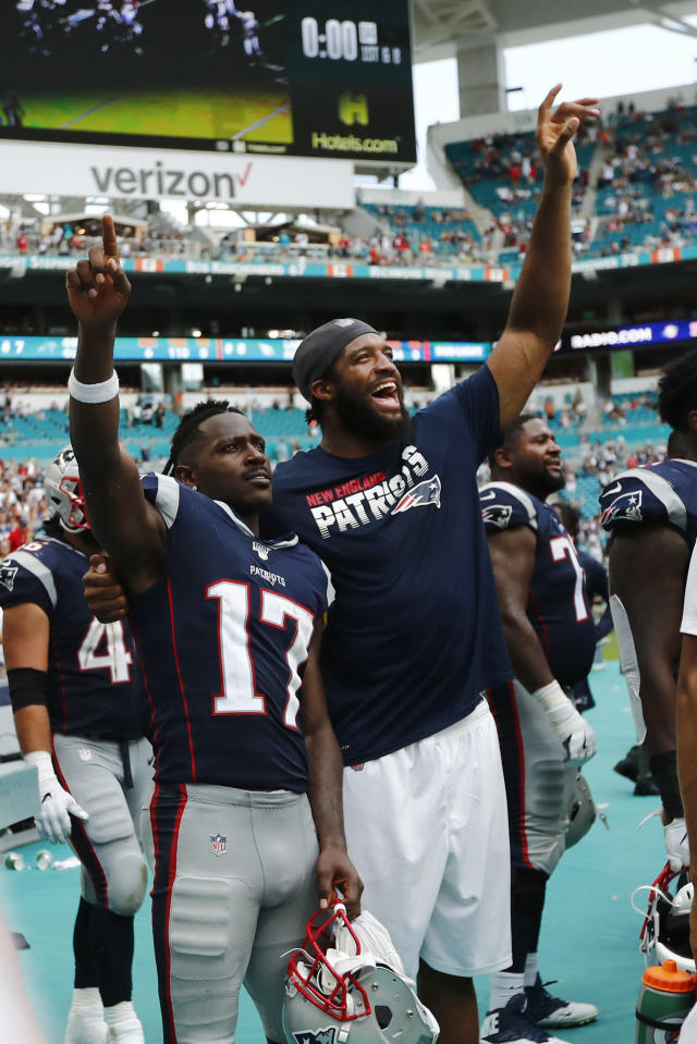 New England Patriots wide receiver Antonio Brown (17) and defensive end Deatrich Wise, celebrate during the end of the second half at an NFL football game, Sunday, Sept. 15, 2019, in Miami Gardens, Fla. The Patriots defeated the Dolphins 43-0. (AP Photo/Brynn Anderson)