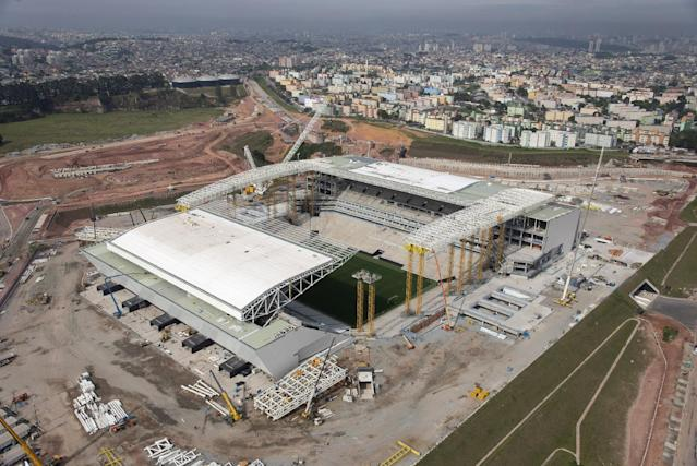 In this photo released by Portal da Copa 2014, an aerial view of the Arena Corinthians stadium, in Sao Paulo, Brazil, Oct. 2013. The draw for the 2014 World Cup finals takes place Friday Dec. 6, 2013 near Salvador, Brazil. The 32 teams will be drawn into eight groups of four. The top two in each group will progress to the knockout stages. Twelve stadiums in twelve cities will host matches.(AP Photo/Portal da Copa 2014, Delfim Martins)