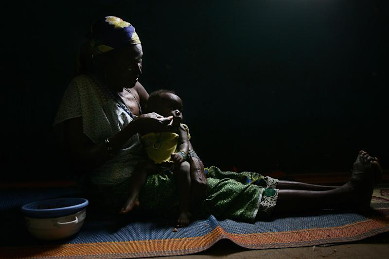 A woman feeds her baby on July 16, 2008 in Maradi, Niger