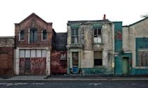 <p>A row of empty buildings memorializes a small-town Main Street that once was.</p>