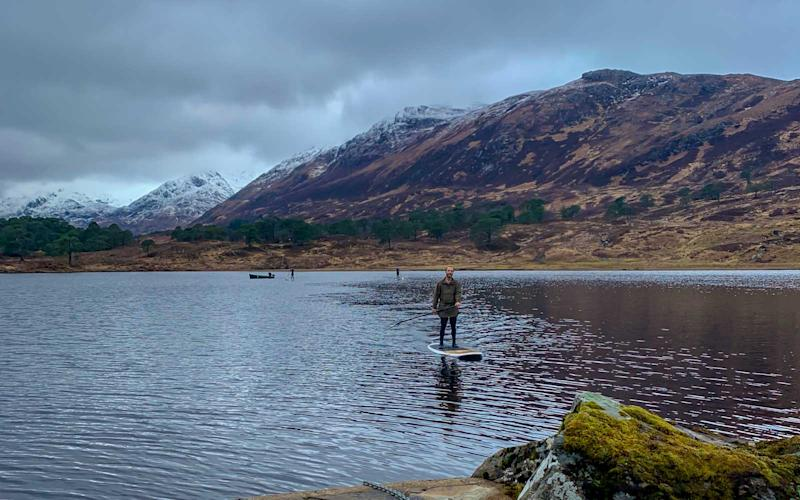 James Middleton takes our group paddleboarding on the Loch Affric. | Talia Avakian
