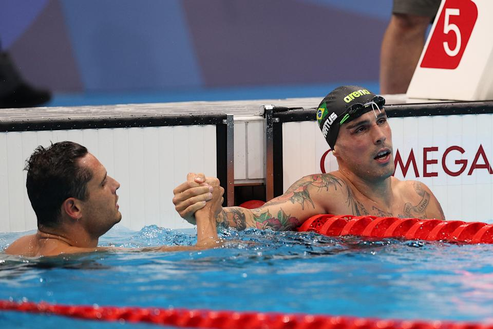 TOKYO, JAPAN - JULY 31: Florent Manaudou of Team France (L) and Bruno Fratus of Team Brazil after competing in the first Semifinal of the Men's 50m Freestyle at Tokyo Aquatics Centre on July 31, 2021 in Tokyo, Japan. (Photo by Maddie Meyer/Getty Images)