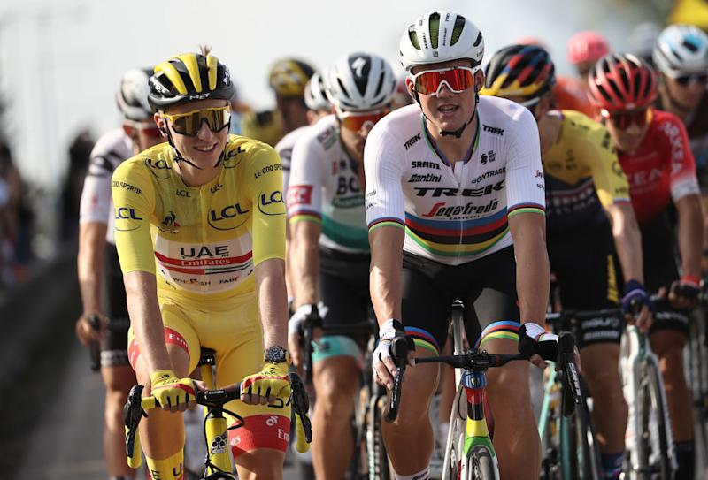 Team UAE Emirates rider Slovenias Tadej Pogacar wearing the overall leaders yellow jersey rides with Team Trek rider Denmarks Mads Pedersen during the 21st and last stage of the 107th edition of the Tour de France cycling race 122 km between ManteslaJolie and Champs Elysees Paris on September 20 2020 Photo by KENZO TRIBOUILLARD AFP Photo by KENZO TRIBOUILLARDAFP via Getty Images
