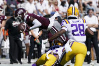 Mississippi State wide receiver Malik Heath (4) fumbles as he is upended by LSU cornerback Cordale Flott (25) during the first half of an NCAA college football game, Saturday, Sept. 25, 2021, in Starkville, Miss. (AP Photo/Rogelio V. Solis)