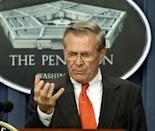 """Then-US defense secretary Donald Rumsfeld speaks to reporters at the Pentagon in Washington in April 2002, only months after the United States had invaded Afghanistan in the opening salvos of the """"war on terror"""""""