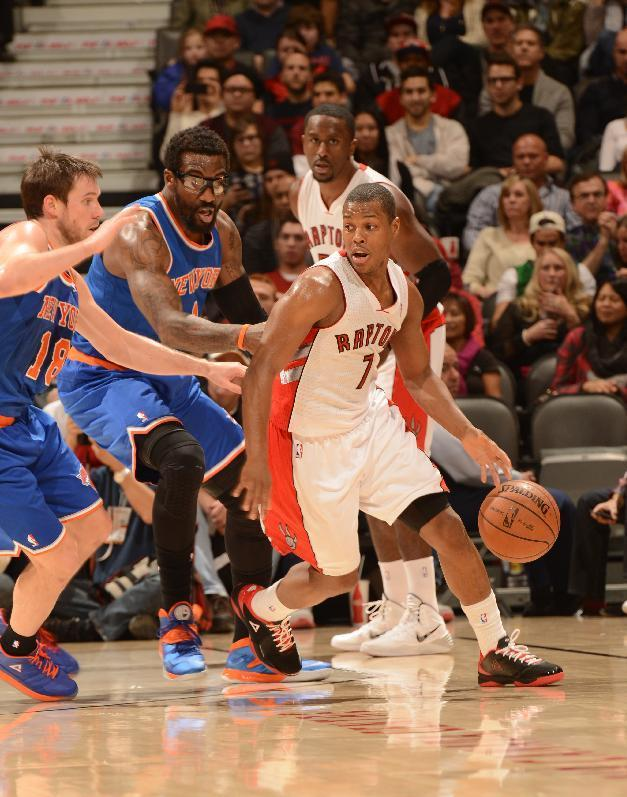 TORONTO, CANADA - December 28: Kyle Lowry #7 of the Toronto Raptors drives against the New York Knicks on December 28, 2013 at the Air Canada Centre in Toronto, Ontario, Canada. (Photo by Ron Turenne/NBAE via Getty Images)