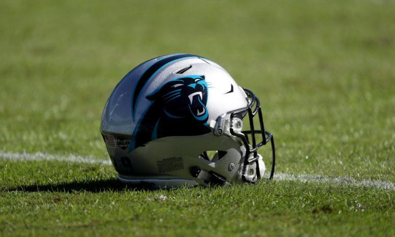 A picture of a Carolina Panthers helmet on the field.