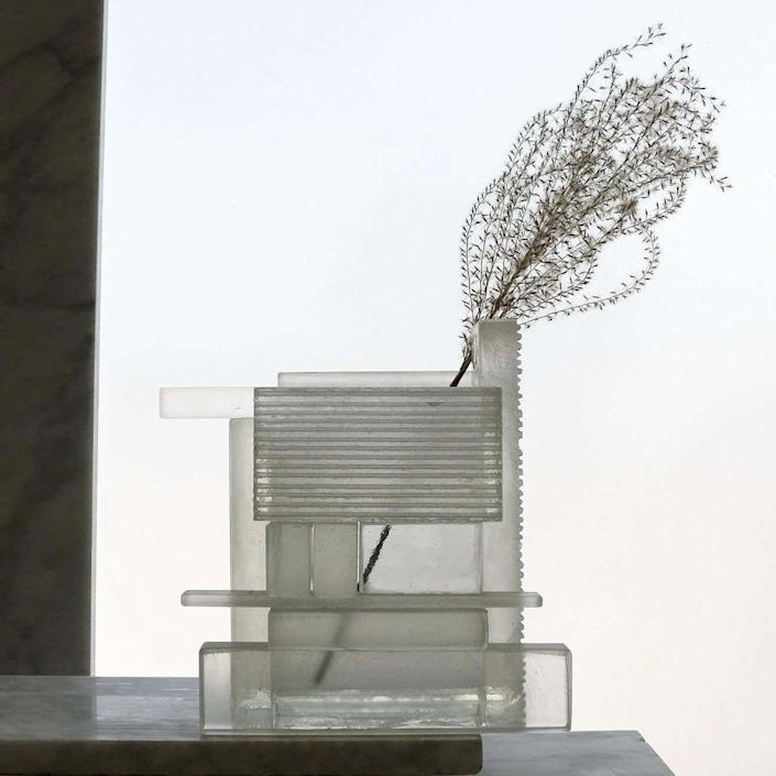 """""""Even without a flower in it, the Quarry Vase is a stunning sculptural object—the fact that it's functional is just a bonus. It's architectural and industrial, yet very delicate because of the transparency (meaning it will also catch the light beautifully)."""" —<a href=""""https://www.architecturaldigest.com/contributor/sophia-herring?mbid=synd_yahoo_rss"""" rel=""""nofollow noopener"""" target=""""_blank"""" data-ylk=""""slk:Sophia Herring"""" class=""""link rapid-noclick-resp"""">Sophia Herring</a>, associate editor $1150, 1stDibs. <a href=""""https://www.1stdibs.com/furniture/decorative-objects/vases-vessels/vases/quarry-vase-clear-glass-hayden-richer/id-f_24293082/"""" rel=""""nofollow noopener"""" target=""""_blank"""" data-ylk=""""slk:Get it now!"""" class=""""link rapid-noclick-resp"""">Get it now!</a>"""
