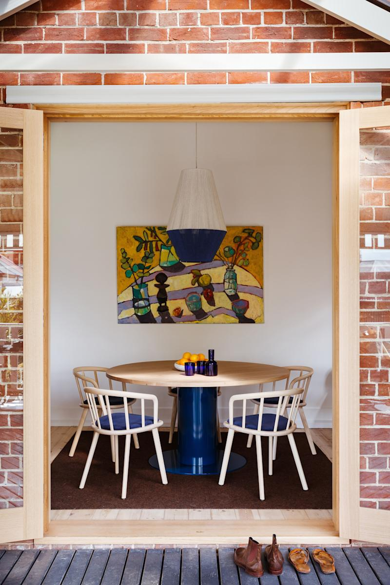 The extra height added to the patio door creates an indoor-outdoor feel to the dining nook.