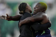 Jessica Ramsey, left, celebrates her first place finish with second place, Jessica Ramsey after the finals of the women's shot put at the U.S. Olympic Track and Field Trials Thursday, June 24, 2021, in Eugene, Ore. (AP Photo/Ashley Landis)