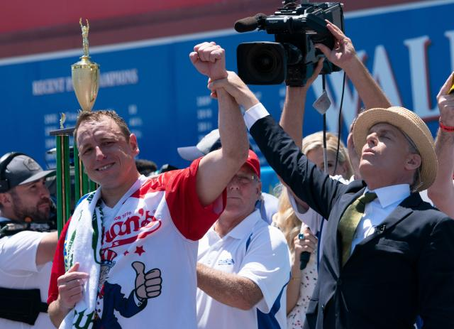 Joey Chestnut isn't having Peter King's criticism of the Nathan's Hot Dog Eating Contest, an event he's now won a record 12 times. (Don Emmert/AFP)