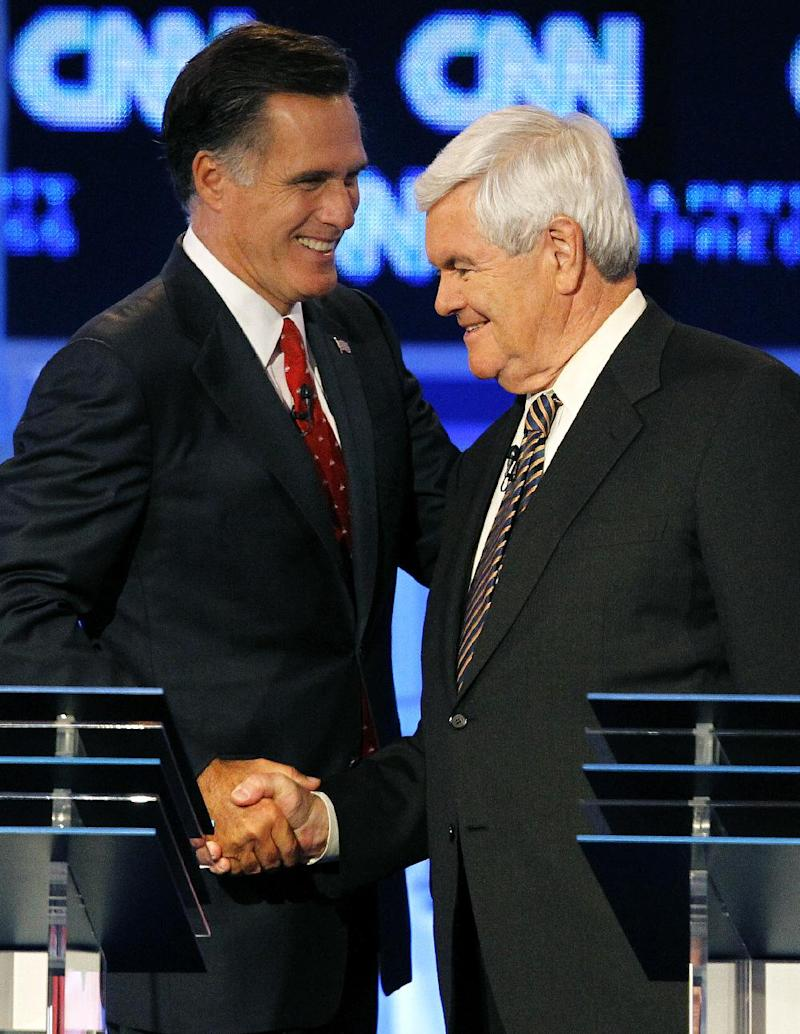 FILE - In this Sept. 12, 2011, file photo Republican presidential candidates former Massachusetts Gov. Mitt Romney, left, and former House speaker Newt Gingrich shake hands after a Republican presidential debate in Tampa, Fla. Gingrich is facing his first debate as the front-runner for the Republican presidential nomination Saturday night, Dec. 10, 2011. Standing next to him will be Romney, whose campaign has launched an all-out offensive against Gingrich's record and leadership style.  (AP Photo/Mike Carlson, File)