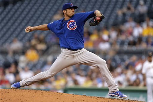 Chicago Cubs starting pitcher Matt Garza (22) delivers in the second inning of a baseball game against the Pittsburgh Pirates in Pittsburgh on Tuesday, May 21, 2013. (AP Photo/Gene J. Puskar)