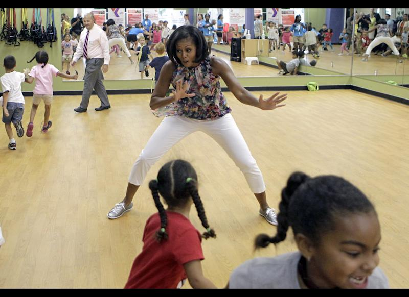 First lady Michelle Obama participates in games during a children's fitness class at the Blanchard Park YMCA, Tuesday, July 10, 2012, in Orlando, Fla.