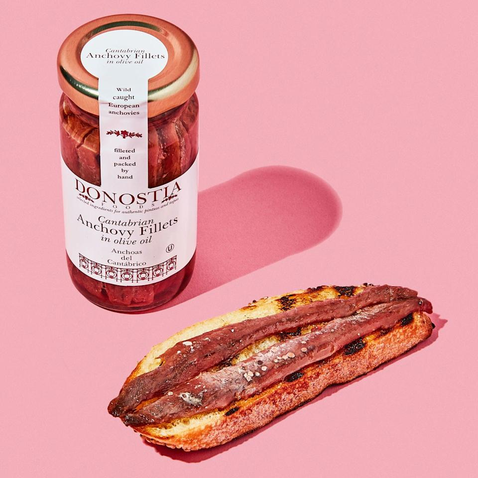"""<p>Not sure if you've noticed, but our staff is obsessed with canned and jarred fish. And these anchovies, from Donostia, a.k.a. San Sebastian, were some of the <a href=""""https://www.bonappetit.com/story/donostia-anchovies?mbid=synd_yahoo_rss"""">best we tried all year</a>. They're so buttery and tender (and subtle in the fishy flavor), that we like to eat them on toast with a slab of butter, on pizza, or plain, lightly dressed with sherry vinegar and olive oil. Oh, and they're sustainably sourced, wild-caught, etc. to boot.</p> <p><br> <strong>Buy It:</strong> <a href=""""https://www.donostiafoods.com/products/anchovies"""" rel=""""nofollow"""" target=""""_blank""""><strong>Donostia Cantabrian anchovies in olive oil, $10 at</strong> <strong>Donastia Foods</strong></a></p>"""