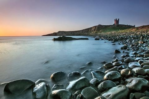 Dunstanburgh Castle Ruins looming in the distance - Credit: istock