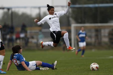 Claudia Soto (top) of Colo Colo women's soccer club jumps of a rival from Universidad Catolica during a match in Santiago May 11, 2014. REUTERS/Ivan Alvarado