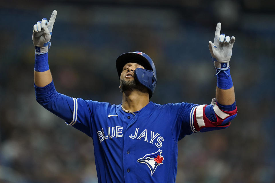 Toronto Blue Jays' Lourdes Gurriel Jr. celebrates his solo home run off Tampa Bay Rays pitcher Shane Baz during the fifth inning of a baseball game Monday, Sept. 20, 2021, in St. Petersburg, Fla. (AP Photo/Chris O'Meara)