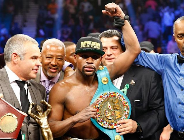 Floyd Mayweather celebrates the unanimous decision victory in his welterweight unification championship bout against Manny Pacquiao, in Las Vegas, Nevada, in May 2015 (AFP Photo/Al Bello)