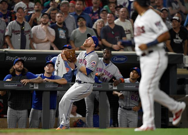 MINNEAPOLIS, MN - JULY 16: Todd Frazier #21 of the New York Mets makes a catch in foul territory with the bases loaded to end the interleague game against the Minnesota Twins on July 16, 2019 at Target Field in Minneapolis, Minnesota. The Mets defeated the Twins 3-2. (Photo by Hannah Foslien/Getty Images)