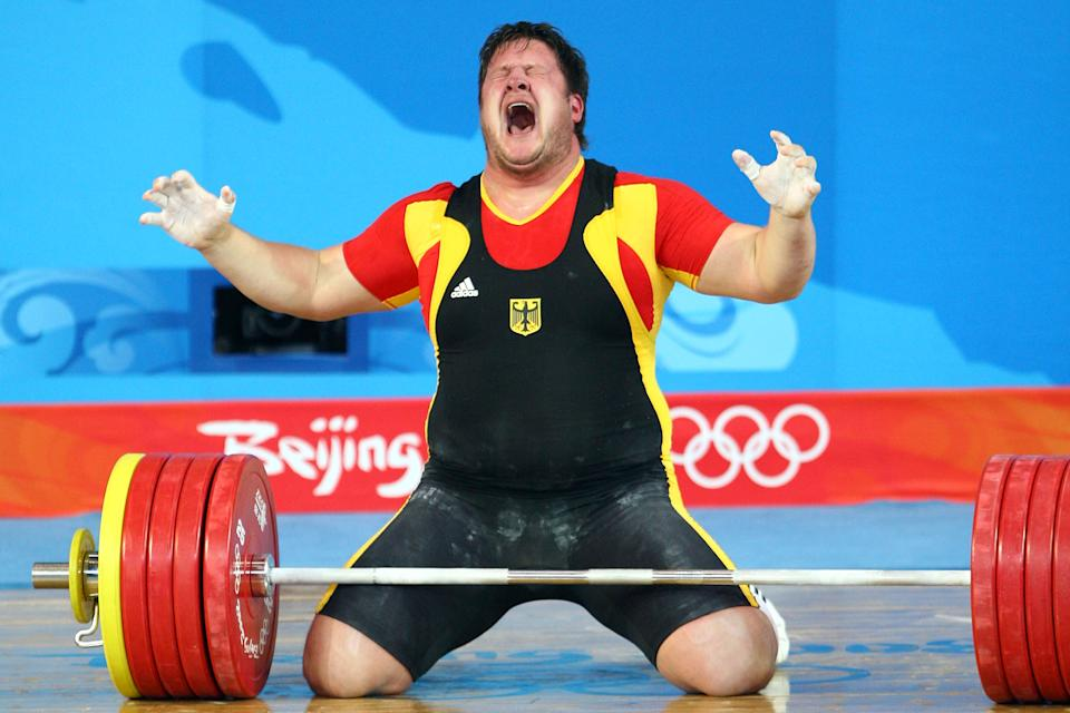 BEIJING - AUGUST 19: Matthias Steiner of Germany celebrates winning the gold medal in the Men's 105 kg group weightlifting event at the Beijing University of Aeronautics & Astronautics Gymnasium on Day 11 of the Beijing 2008 Olympic Games on August 19, 2008 in Beijing, China. (Photo by Julian Finney/Getty Images)