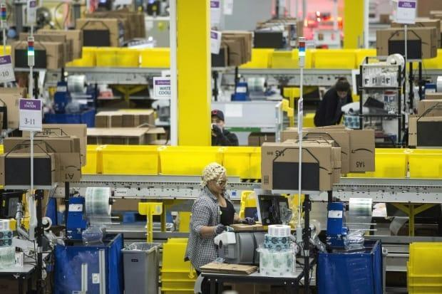All employees at an Amazon facility in Brampton, Ont., have been ordered to self-isolate for two weeks amid an ongoing outbreak of COVID-19. (Chris Young/The Canadian Press - image credit)