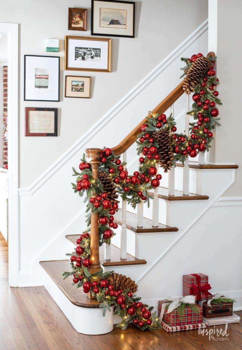 """<p>Dress faux garland with ornaments, lights, and giant pine cones for an eye-catching display that takes your holiday decor to the next level of """"wow!""""<br></p><p><strong>See more at <a href=""""https://inspiredbycharm.com/my-entryway-christmas-decor/"""" rel=""""nofollow noopener"""" target=""""_blank"""" data-ylk=""""slk:Inspired by Charm."""" class=""""link rapid-noclick-resp"""">Inspired by Charm.</a></strong></p><p><a class=""""link rapid-noclick-resp"""" href=""""https://www.amazon.com/Christmas-Natural-Ornaments-Decorating-Designing/dp/B08C368NS2/ref=sr_1_8?dchild=1&keywords=giant+pine+cones&qid=1633170328&sr=8-8&tag=syn-yahoo-20&ascsubtag=%5Bartid%7C2164.g.37723896%5Bsrc%7Cyahoo-us"""" rel=""""nofollow noopener"""" target=""""_blank"""" data-ylk=""""slk:SHOP GIANT PINE CONES"""">SHOP GIANT PINE CONES</a> </p>"""